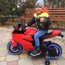 Детский электромотоцикл Ducati 12V- FT-1628 красный (колеса светящиеся, сиденье кожа, музыка, страховочные колеса, ручка газа)