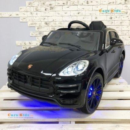 Электромобиль Porsche Cayenne SX1688 черный (легкосъемный аккумулятор, колеса резина, кресло кожа, пульт, музыка)